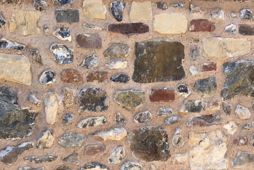 Close up of the completed flint stone wall