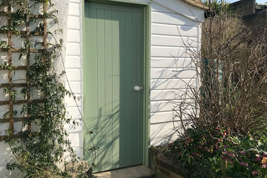 Entrance door to the completed outhouse